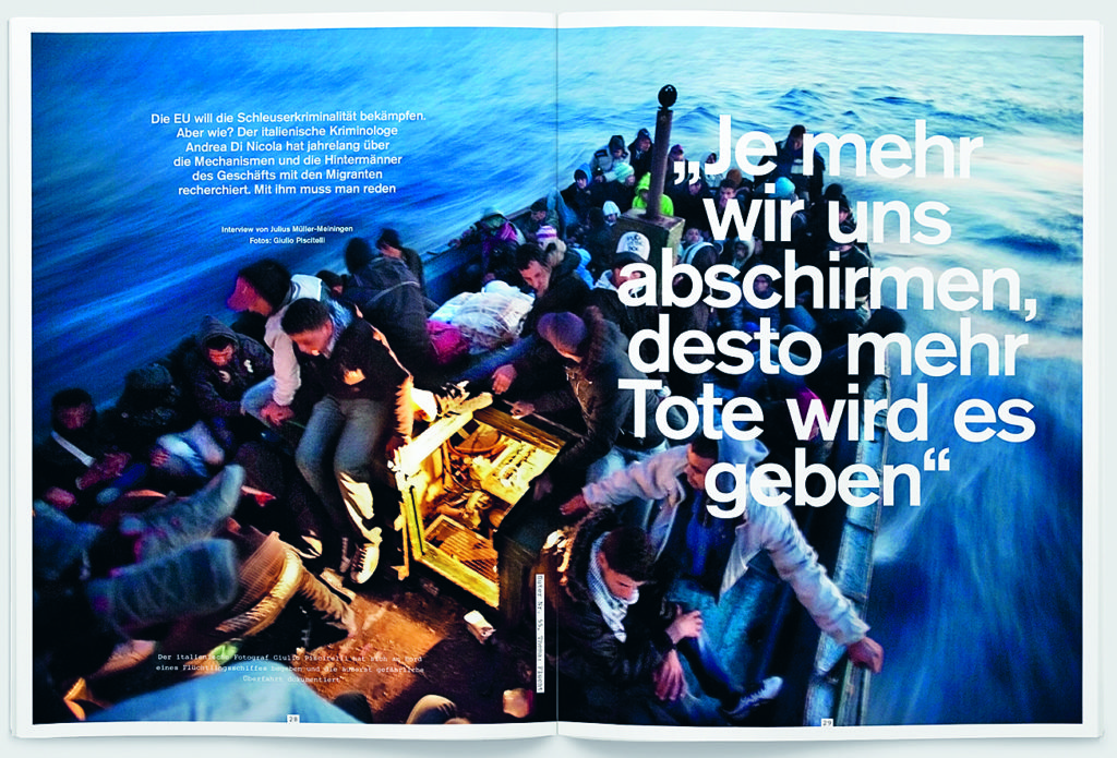 Giulio Piscitelli'a photograph of migrants crossing the Mediterranean in a spread from the 'Flucht' issue.